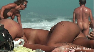 Nudist beach movie scene introduces great looking undressed sweethearts