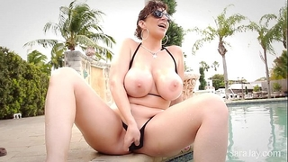 Sara jay shows off her outstanding large billibongs in small bikini