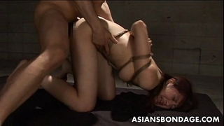 Tied up japanese cutie stuffed with a thick hard pecker