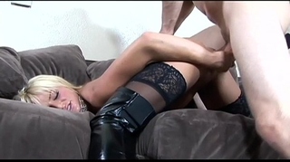 Busty golden-haired drilled in dark boots over nylons