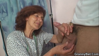 Sewing granny enjoys riding youthful knob