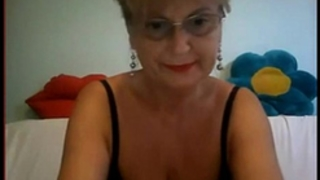 Big breasts granny in glass masturbating on webcam