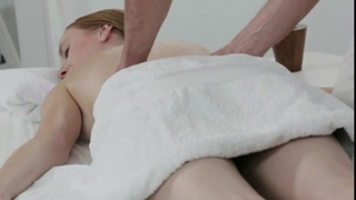 Pale redhead screwed by masseur on a table
