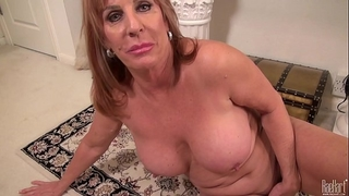 Big titted older mama on the rug in costume