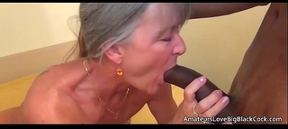 Grey haired granny enjoys large dark penis