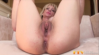 Milf shows biggest clitoris