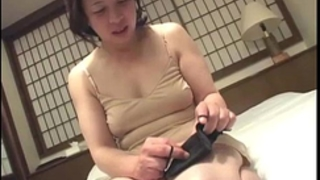 Asian granny inserts a dildo in her vagina