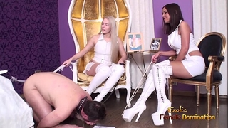 Cuckold thrall giving a kiss boots and getting whipped