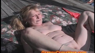Granny screwed by dark gang in yard