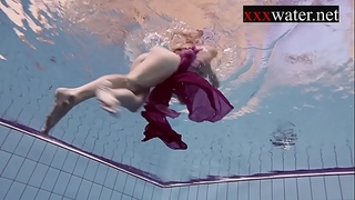 Smoking hawt russian redhead in the pool